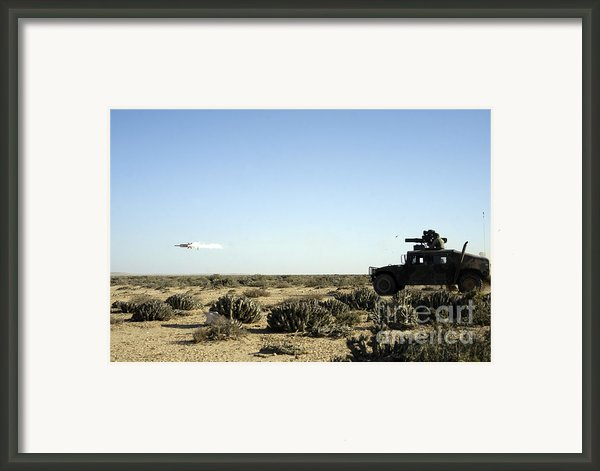 A Soldier Tests His Skill With The Tube Framed Print By Stocktrek Images