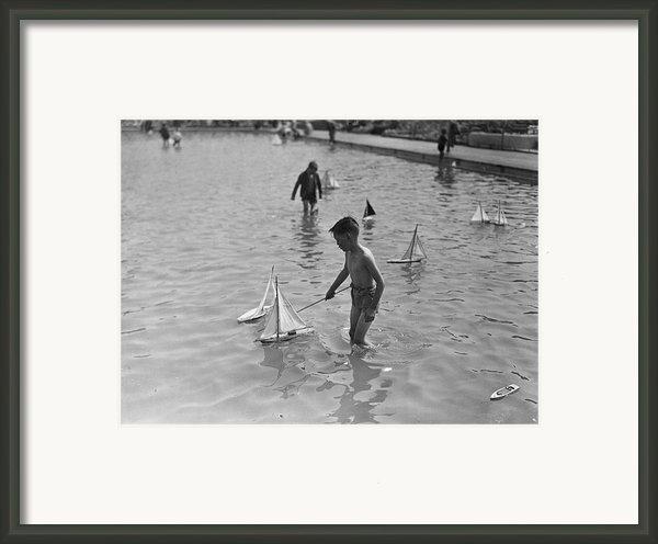 A Toy Boat Framed Print By H F Davis