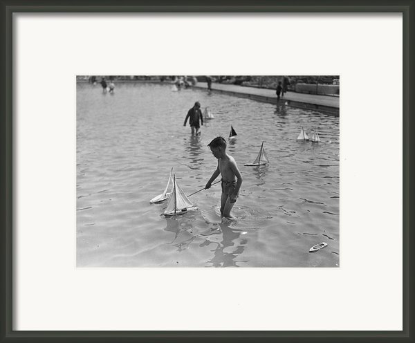 A Toy Boat Framed Print By H F Davis