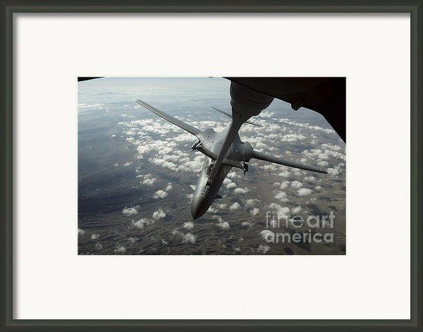 A U.s. Air Force Kc-10 Refuels A B-1b Framed Print By Stocktrek Images
