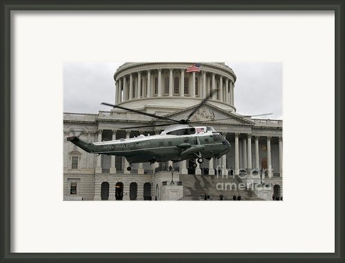 A Vh-60 Helicopter Lands In Front Framed Print By Stocktrek Images