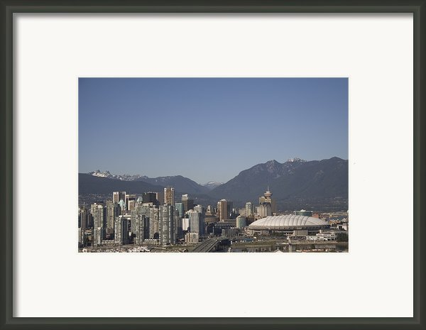 A View Of The Skyline Of Vancouver, Bc Framed Print By Taylor S. Kennedy