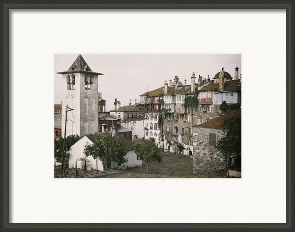 A White Bell Tower Stands Bright Framed Print By Maynard Owen Williams