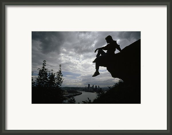 A Woman Perched On An Overlook Framed Print By Lynn Johnson
