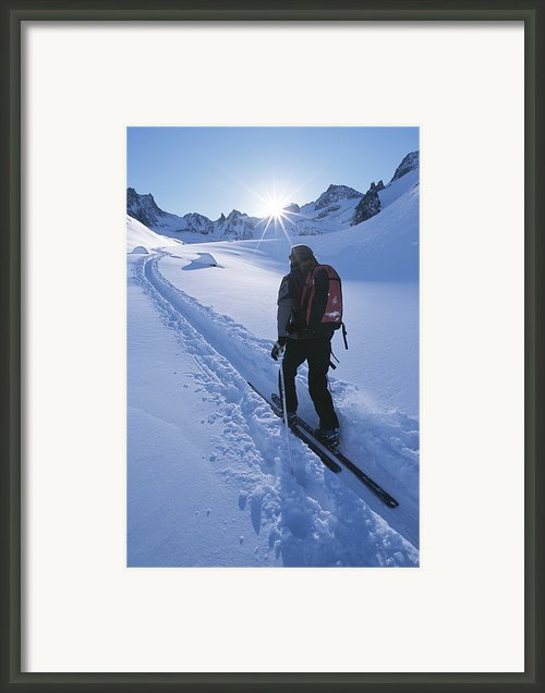 A Woman Skiing In The Selkirk Framed Print By Jimmy Chin