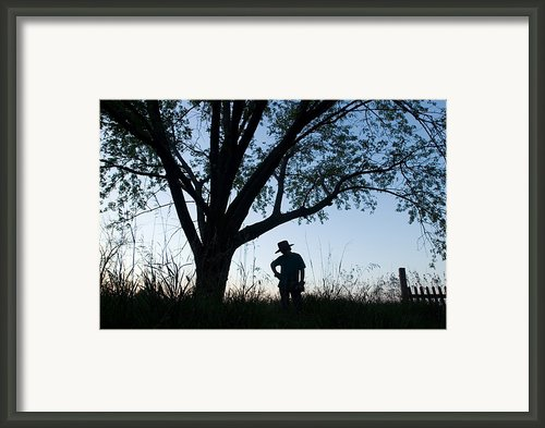 A Young Boy Is Silhouetted Framed Print By Joel Sartore