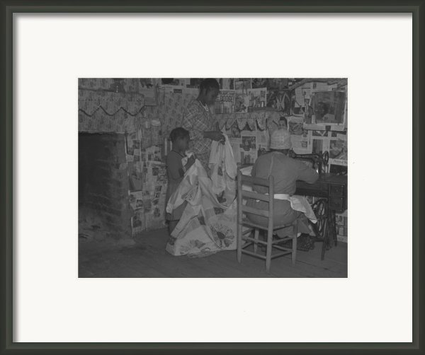 African American Mother Is Assisted Framed Print By Everett