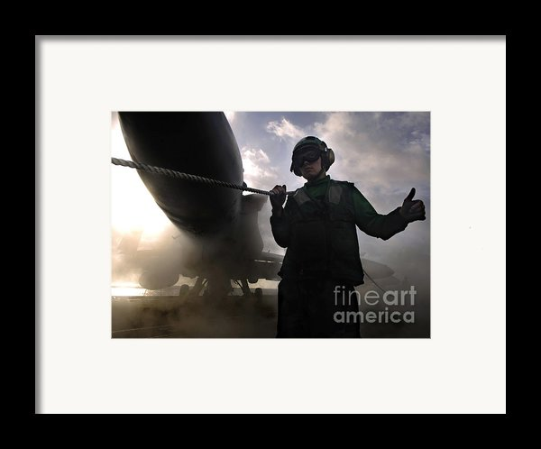 Airman Holds Up The Safety Shot Line Framed Print By Stocktrek Images
