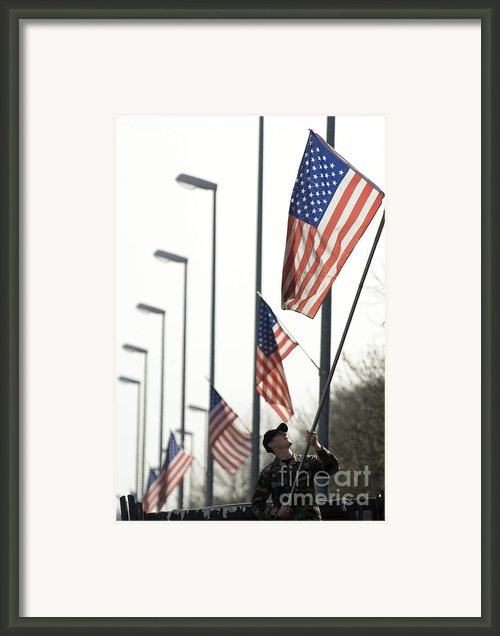 Airman Posts A New Flag On The Main Framed Print By Stocktrek Images
