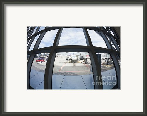 Airplane Parked At Gate Framed Print By Don Mason