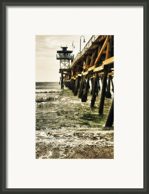 Along The Pier Framed Print By Barbara Eads
