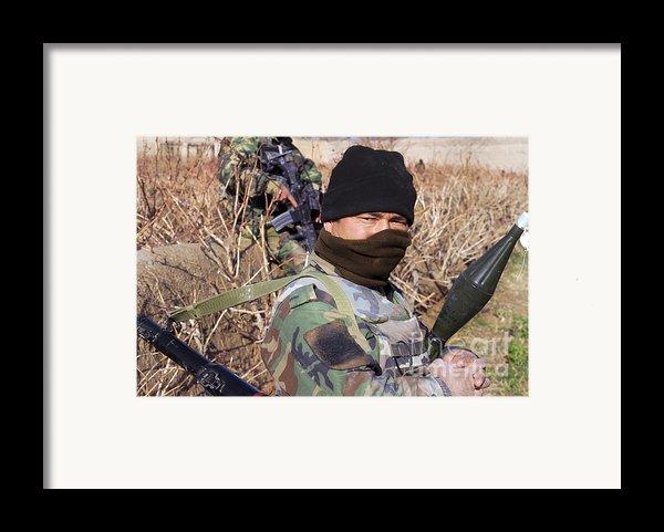 An Afghan Commando On Patrol Framed Print By Stocktrek Images