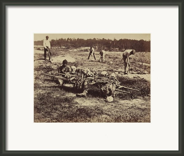 An African American Soldier Of A Burial Framed Print By Everett