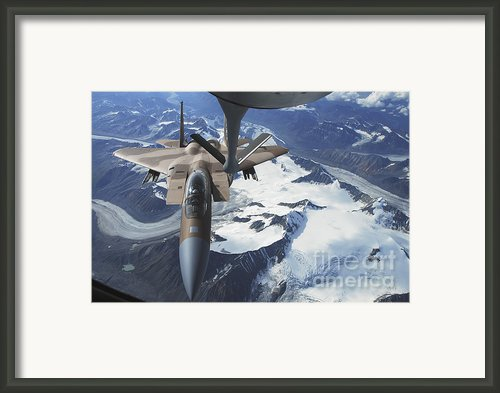 An F-15c Eagle Aircraft Sits Framed Print By Stocktrek Images