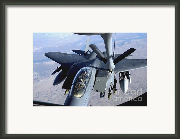 An F-15e Strike Eagle Refuels Over Iraq Framed Print By Stocktrek Images