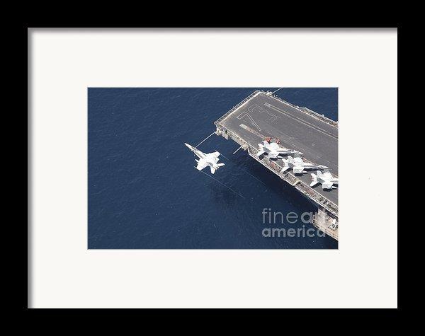 An Fa-18 Hornet Flys Over Aircraft Framed Print By Stocktrek Images