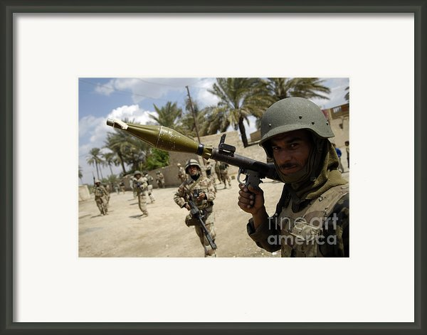 An Iraqi Army Soldier Provides Security Framed Print By Stocktrek Images
