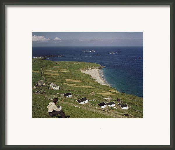 An Irishman Overlooks Cottages That Framed Print By Howell Walker