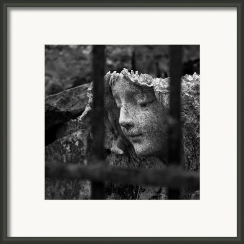 Angel In Bars Framed Print By David Waldo