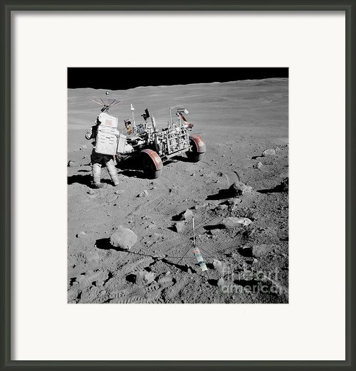 Apollo 16 Astronaut Stands Framed Print By Stocktrek Images