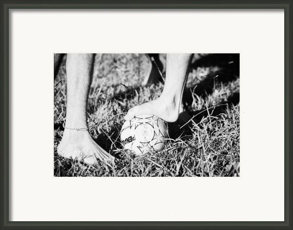 Argentinian Hispanic Men Start A Football Game Barefoot In The Park On Grass Framed Print By Joe Fox