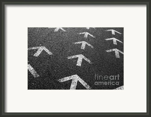 Arrows On Asphalt Framed Print By Carlos Caetano