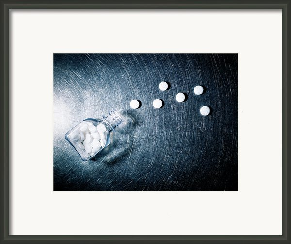 Aspirin Spilled From Bottle On Stainless Steel. Framed Print By Ballyscanlon