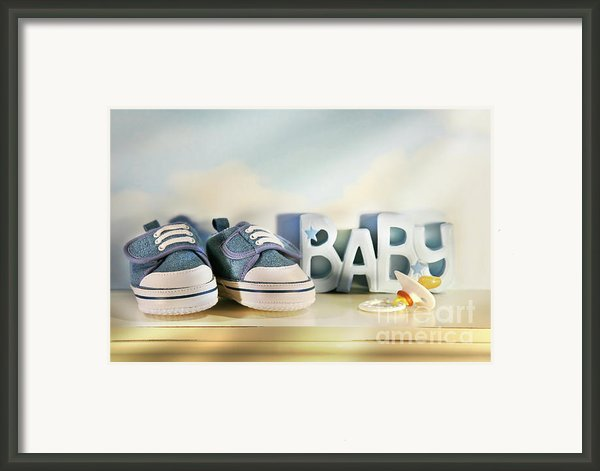 Baby Denim Shoes Framed Print By Sandra Cunningham
