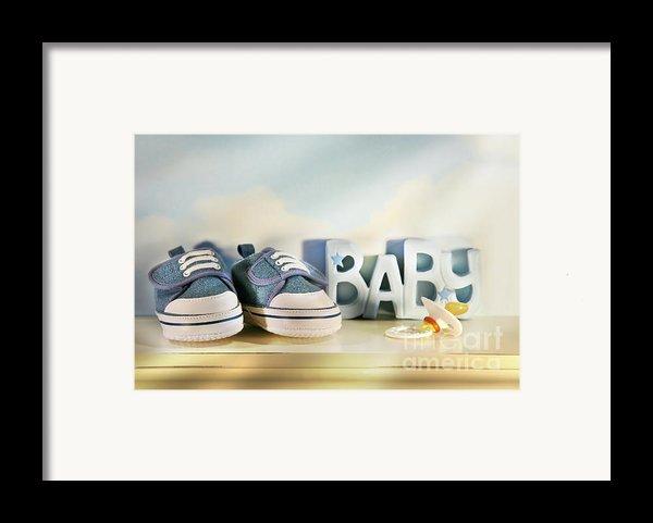 Baby Denim Shoes Framed Print By Sandra Cunningham