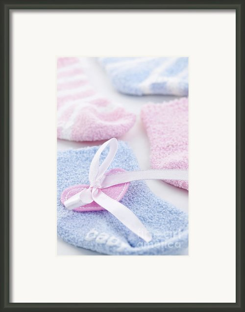 Baby Socks  Framed Print By Elena Elisseeva