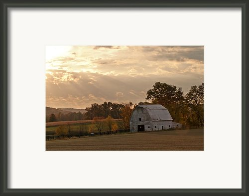 Barn In Warming Storm Framed Print By Randall Branham