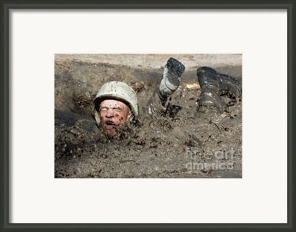 Basic Cadet Trainees Attack The Mud Pit Framed Print By Stocktrek Images