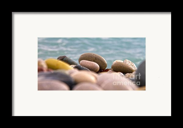 Beach And Stones Framed Print By Stylianos Kleanthous