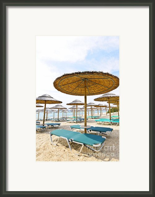 Beach Umbrellas And Chairs On Sandy Seashore Framed Print By Elena Elisseeva