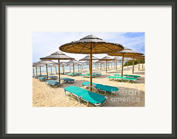 Beach Umbrellas On Sandy Seashore Framed Print By Elena Elisseeva