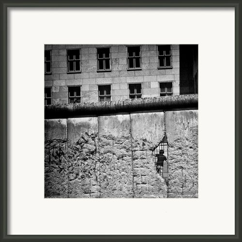 Beyond The Wall Framed Print By David Bowman