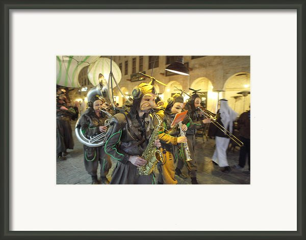 Bizarre Street Band In Doha Framed Print By Paul Cowan