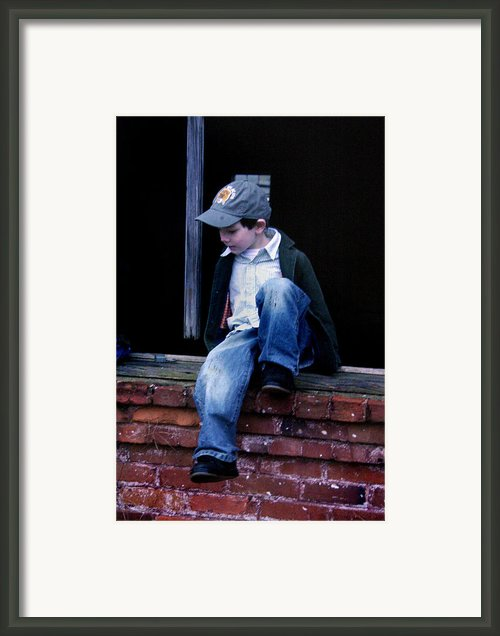 Boy In Window Framed Print By Kelly Hazel