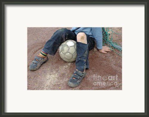 Boy With Soccer Ball Sitting On Dirty Field Framed Print By Matthias Hauser