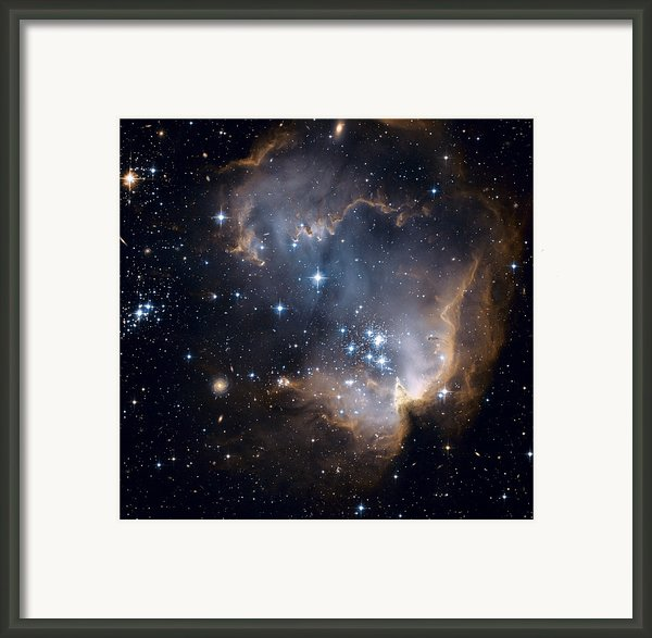 Bright Blue Newborn Stars Blast A Hole Framed Print By Esa And Nasa