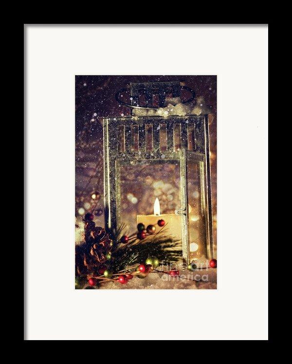 Brightly Lit Lantern In The Snow Framed Print By Sandra Cunningham