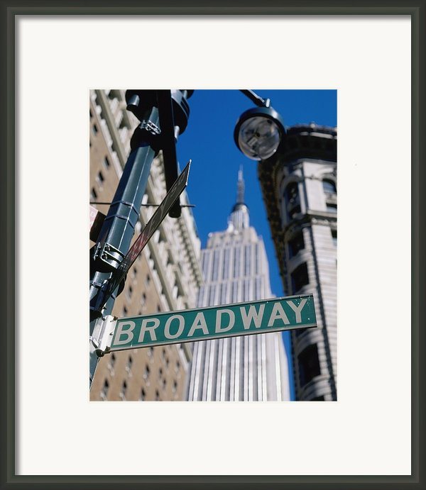 Broadway Sign And Empire State Building Framed Print By Axiom Photographic