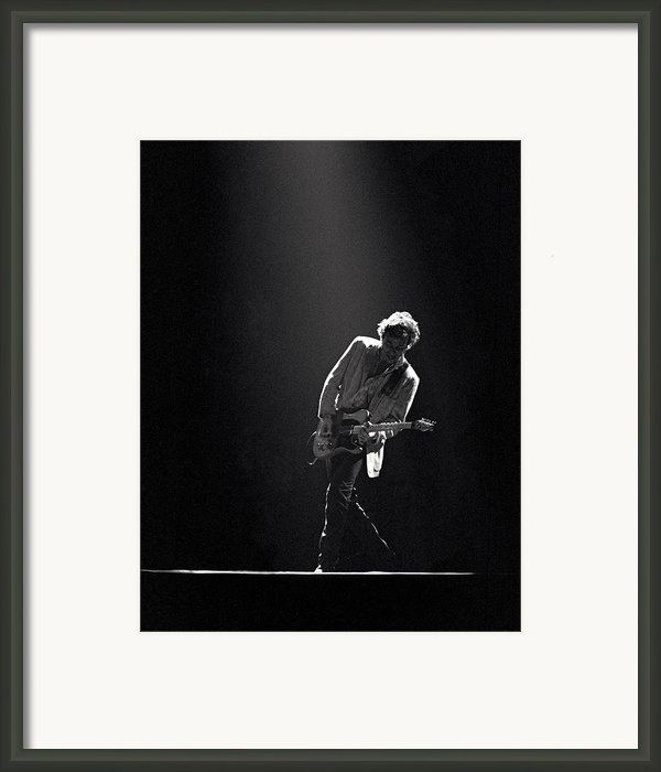 Bruce Springsteen In The Spotlight Framed Print By Mike Norton