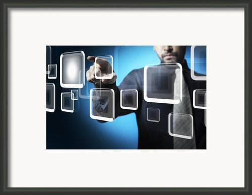 Businessman Touching Screen Button Framed Print By Setsiri Silapasuwanchai