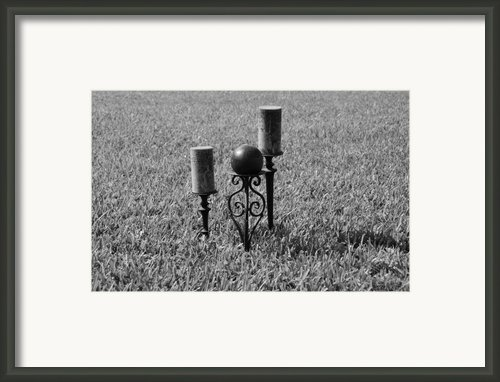 Candles In Grass Framed Print By Rob Hans