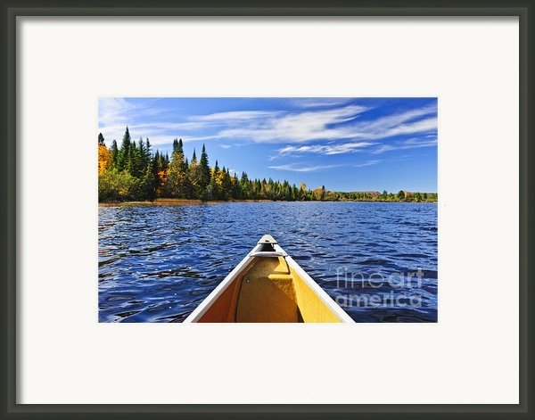 Canoe Bow On Lake Framed Print By Elena Elisseeva