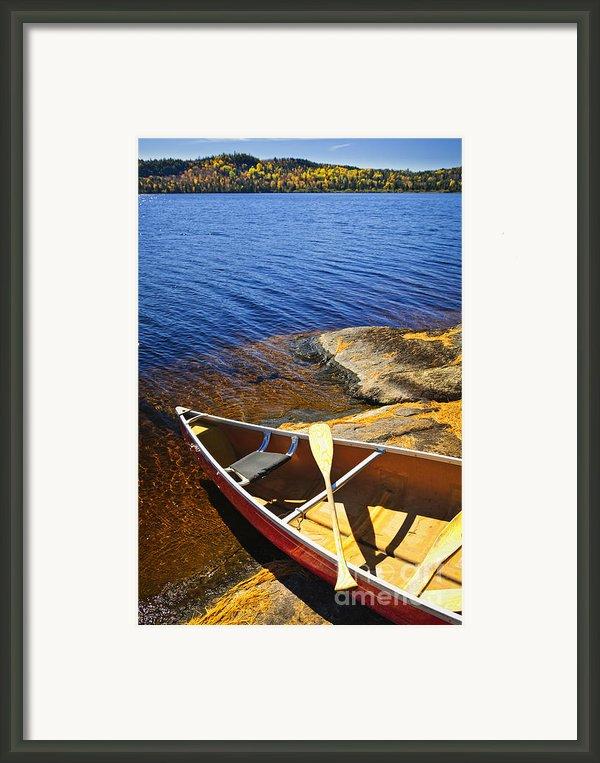 Canoe On Shore Framed Print By Elena Elisseeva