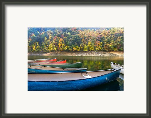 Canoes At Fontana Framed Print By Debra And Dave Vanderlaan
