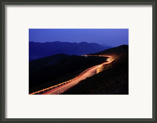 Car Light Trail In Mountain Highway Framed Print By Samyaoo