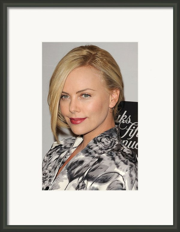 Charlize Theron At In-store Appearance Framed Print By Everett